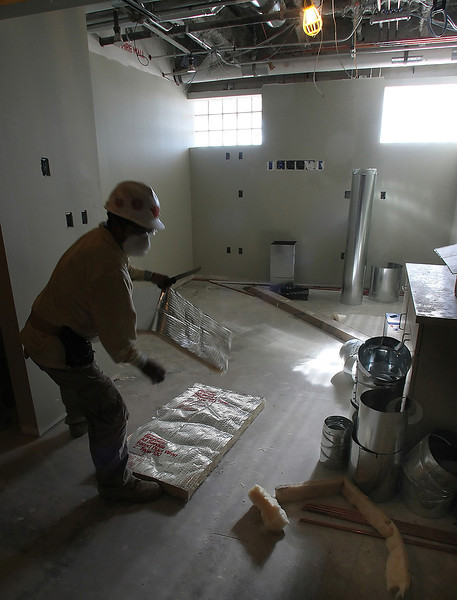 A contractor works to complete the remodeling of patient suite in the Emergency Room at the OSU Medical Center in Tulsa.