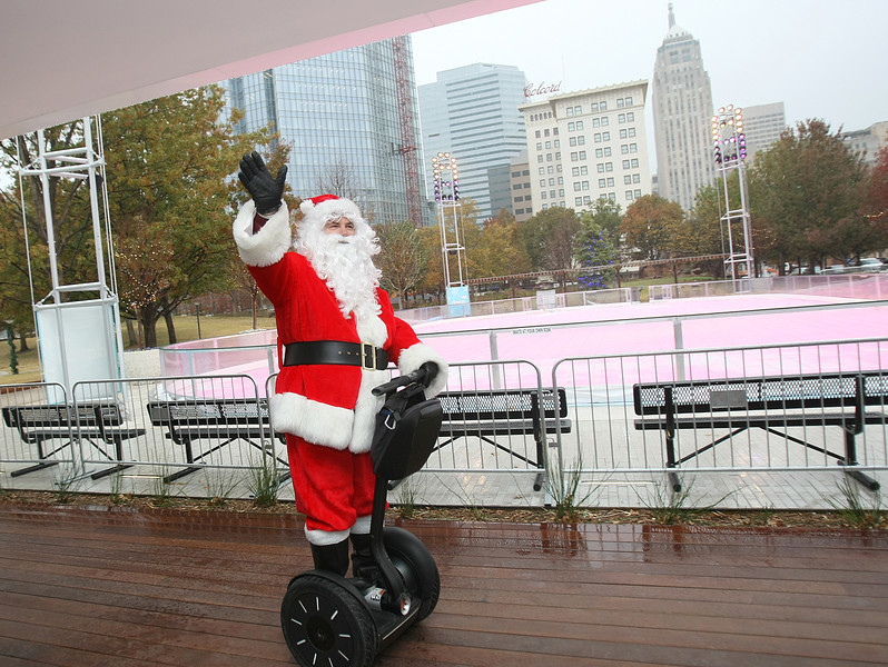 Santa in front of the new Devon Ice Rink at the Myriad Botanical Gardens Monday. PHOTO BY MAIKE SABOLICH