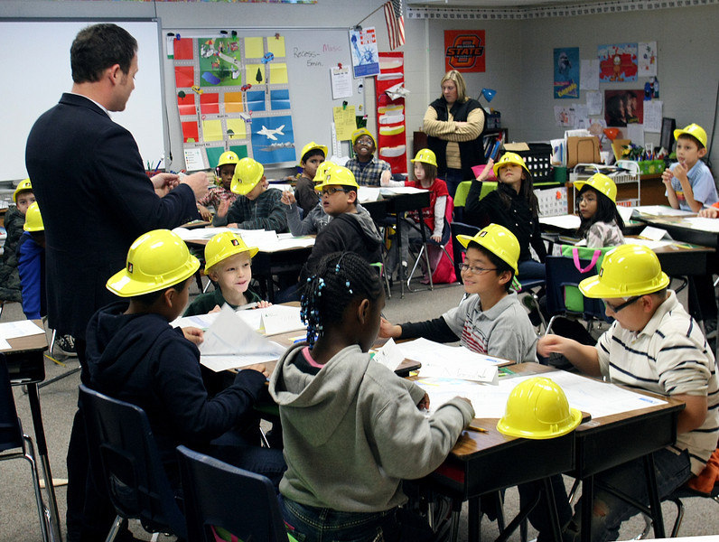 Students at the Roy Clark Elementary school in Tulsa are well equipped with their hard hats while working with a guest teacher with  The TulsaEntrepreneurs' Organization of Oklahoma.