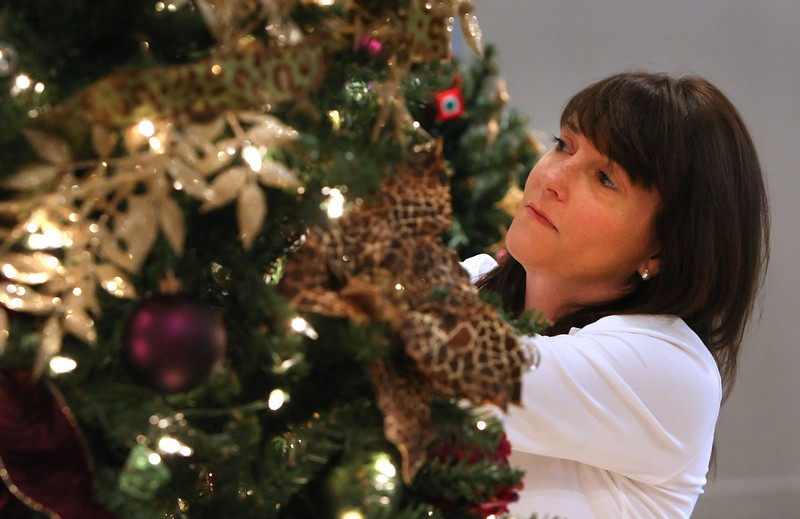 Dona Windsor decorates a christmas tree from the Alzheimer's association for the Philbrook Museum's Festival of Trees.  The tree is auctioned off and the proceeds are split.