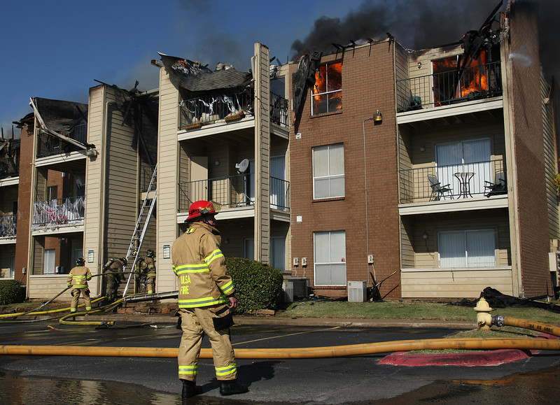 Firemen fight a Two Alarm fire at the Windsail apartments in Tulsa.  Thirty mph wind gusts made the fire involving one building in the complex difficult to control.
