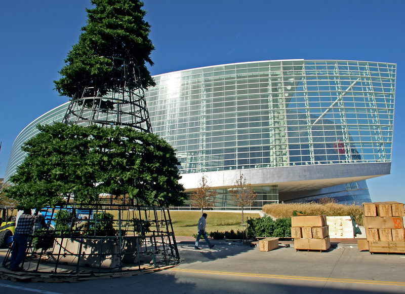 Workmen erect a nearly 40 foot tall Christmas tree outside near the BOK Center in downtown Tulsa.