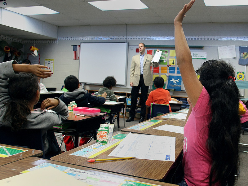 Third Grade students at the Roy Clark Elementary school in Tulsa  raise their hands to answer Clay Slaton, CEO and owner of EngATech, questions.  The TulsaEntrepreneurs' Organization of Oklahoma were guest teaching at the School.