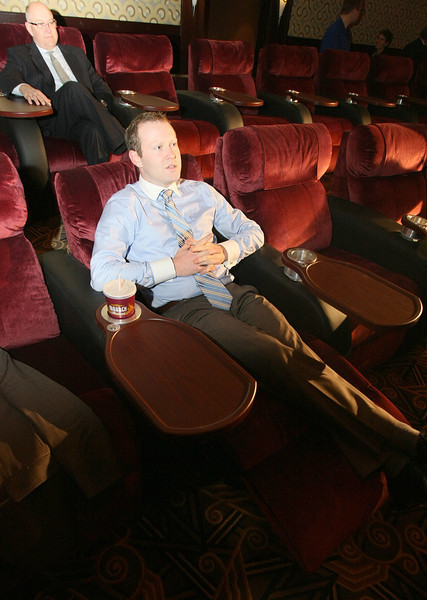 "Casey Cornett tries out the chairs of the the new ""Director's Suite"" at the Warren Theater. PHOTO BY MAIKE SABOLICH"