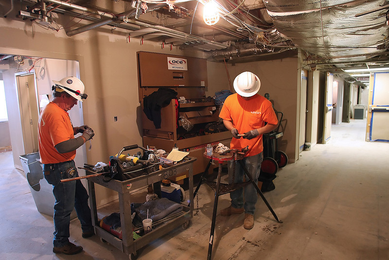 Contractors work to complete the remodeling of the Emergency Room at the OSU Medical Center in Tulsa.