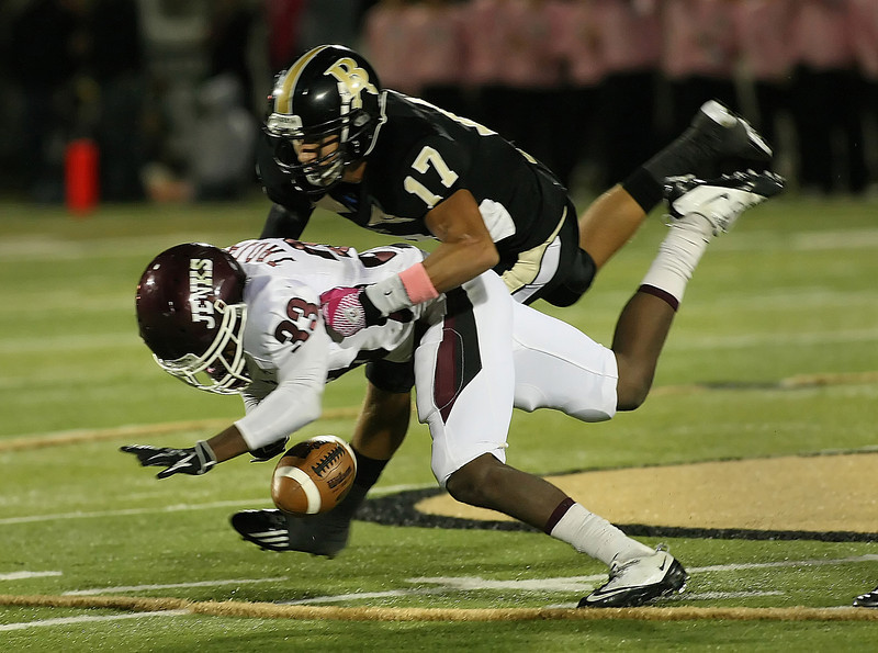 Jenks Wide Reciever Trey'Vonne Barr'e looses the ball as Broken Arrow 's Levi Copelin tackles him.  Copelin recovered the fumble and returned the ball for a touchdown.
