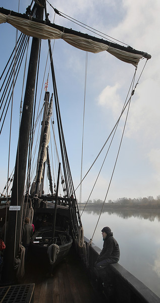 A crew member of the Columbus Replica Ship, the Pinta rests between groups of school childeren touring the ship anchored in the Three Rivers Harbor in Muskogee. The ship will stay through December 8th and is available to touring.