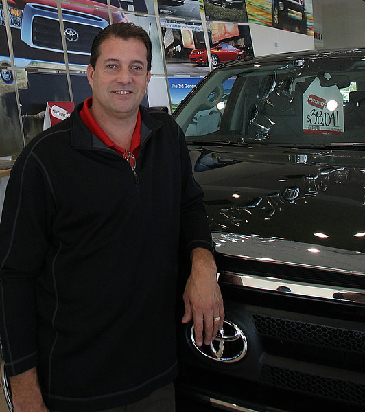 Kevin McPhail , General Sales Manager of Momentum Toyota of Tulsa, pauses for  a photo on the sales floor of the dealership.