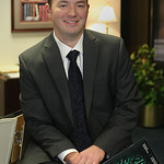Joseph McIntye, Branch manager of Consulting Services for Robert Half in Tulsa,holds the companies 2012 Salary guide.