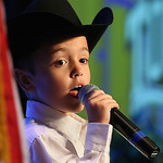 Seven year old Rodeo Opey performer Maddox Roff belts out a song to open the Governors Conference on Tourism held in Tulsa.