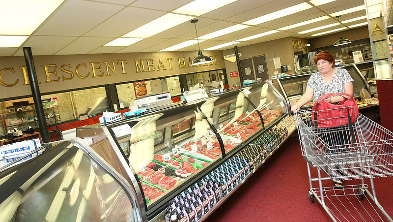 Janis Powers in Crescent Market's meat area Monday. Crescent Market is closing by the end of the month. PHOTO BY MAIKE SABOLICH