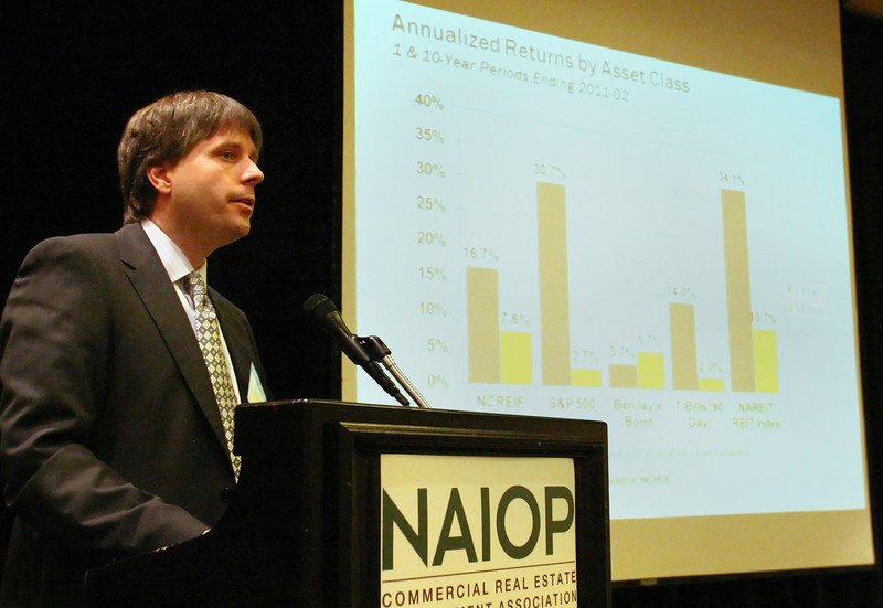 Rene Circ, VP and National Director of Research Industrial for Grubb & Ellis gives his presentation during the NAIOP Tulsa Trends Conference Thursday.