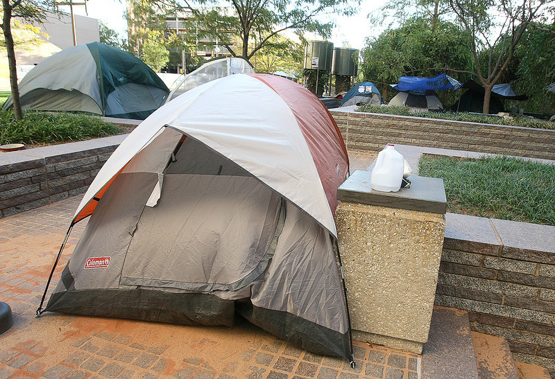 Occupy OKC  tents at Kerr Park Tuesday morning.  The group had decided against marching to City Hall that morning and show up in smaller numbers at the City Council meeting instead to ask for fees of park residency to be waived.  PHOTO BY MAIKE SABOLICH