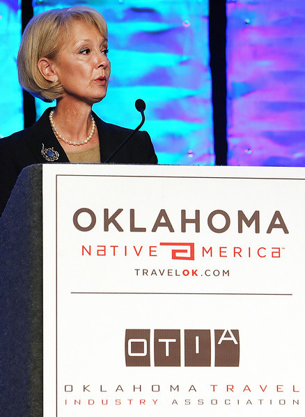 Debby Snodgrass, Executive Director of the Oklahoma Tourism and Recreation Department, welcome attendees to the the Governors Conference on Tourism held in Tulsa.
