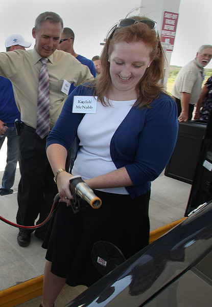 Kylah McNabb fuels a vehicle with CNG.