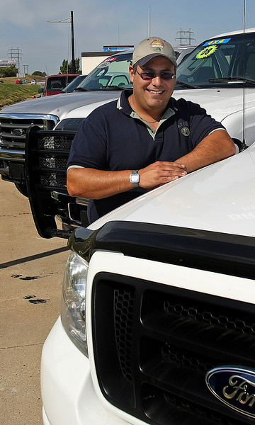 Ted Massad pauses for a photo at the CNG Oklahoma Autosales lot in Tulsa.
