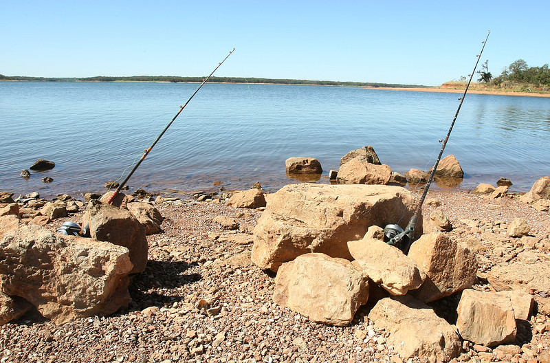 Fishing poles at Lake Thunderbird State Park Tuesday. PHOTO BY MAIKE SABOLICH