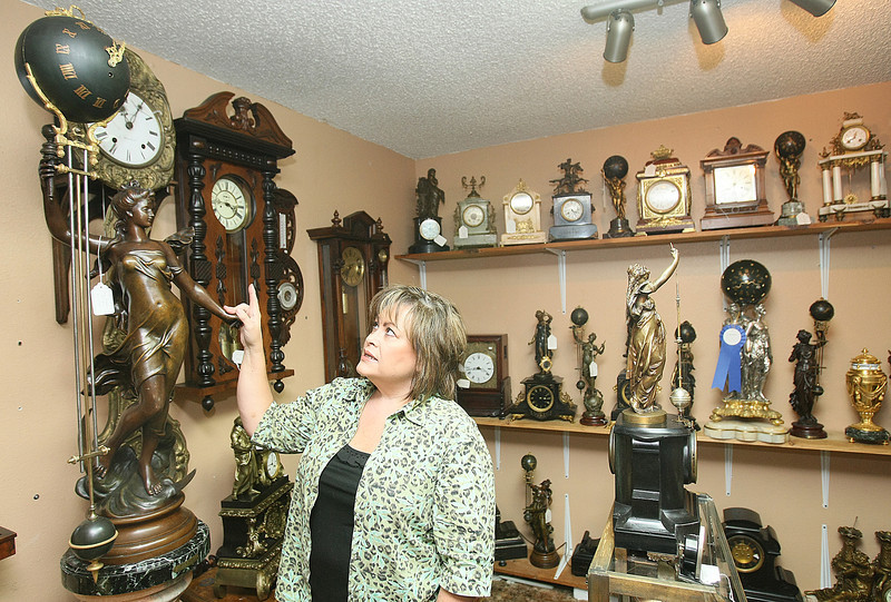 Rose Michael shows a so-called mystery clock at her shop on Ski Island. PHOTO BY MAIKE SABOLICH