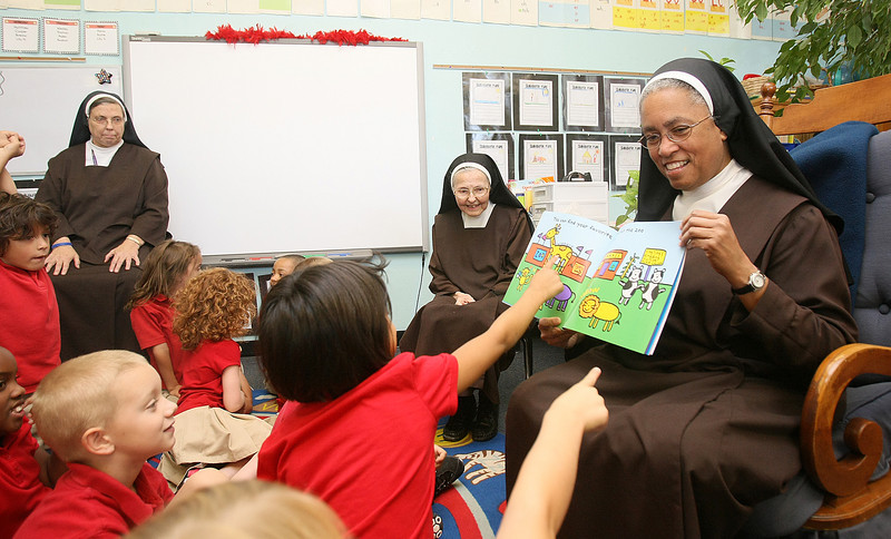 Villa Teresa Catholic School Principle Sister Veronica Higgins, right, Sister Joseph Marie Gibbons and Mary Frances Coker attend the first grade class Monday.  PHOTO BY MAIKE SABOLICH