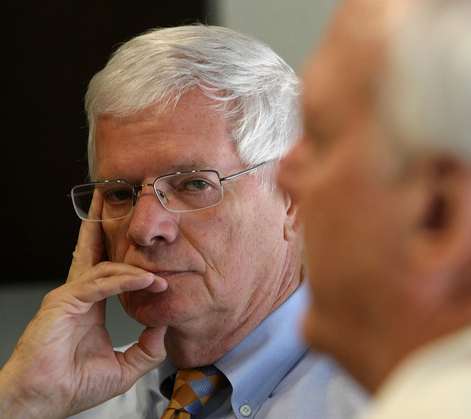 Bill Anderson listens to H. Wayne Cooper attorneys at Doerner Saunders Daniel and Anderson.