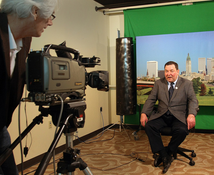 Small business ambassador Larry Mocha records a commercial about an upcoming small business conference in Tulsa.