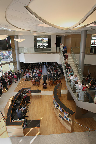 Spectators crowd the lobby of the new University of Oklahoma Tulsa Schusterman Library, during the structures dedication ceremony Monday.