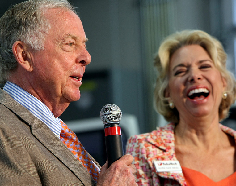 Boone Pickens and Dr. Kara Gae Neal. Superintendant of Tulsa Tech, share a laugh at the dedication of the schools Automotive, Robotics and Manufacturing campus in Broken Arrow.