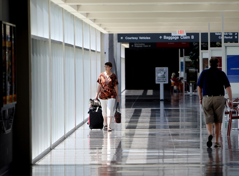 A Traveler walks through Tulsa International Airport after arriving in Tulsa.