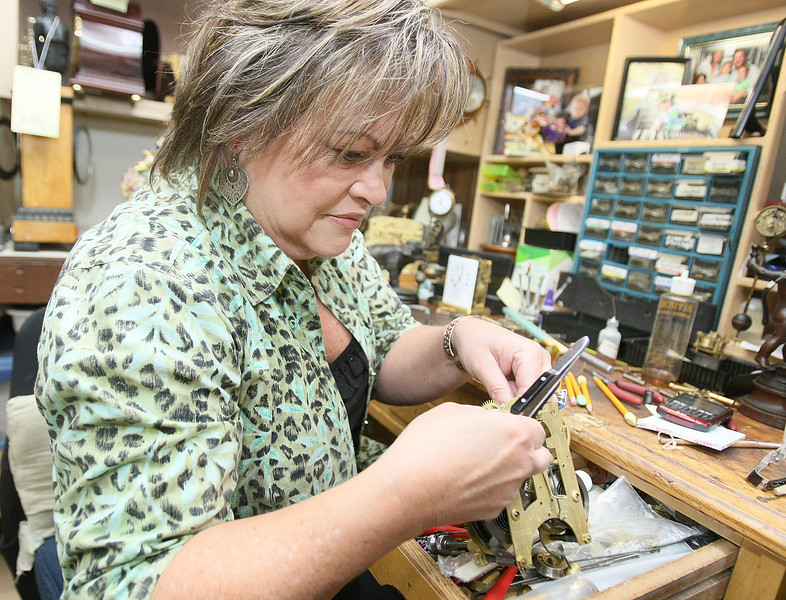 Rose Michael works on clock at her shop on Ski Island. PHOTO BY MAIKE SABOLICH