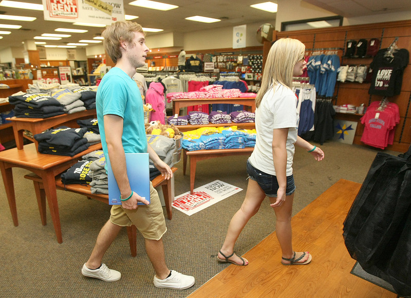Peyton Howell and Jacke Rice leave the Rose State College bookstore Thursdasy. PHOTO BY MAIKE SABOLICH