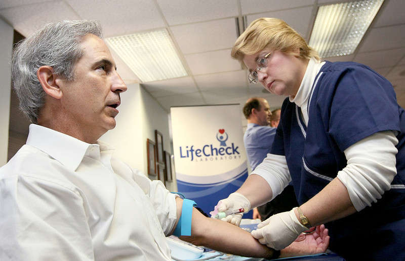 Victor Bird with the Oklahoma Aeronautical Commission gets his blood drawn by Cindy Pickens, general manager of LifeCheck Laboratories,  on the 11th floor of the First National Building in 2009. PHOTO BY MAIKE SABOLICH