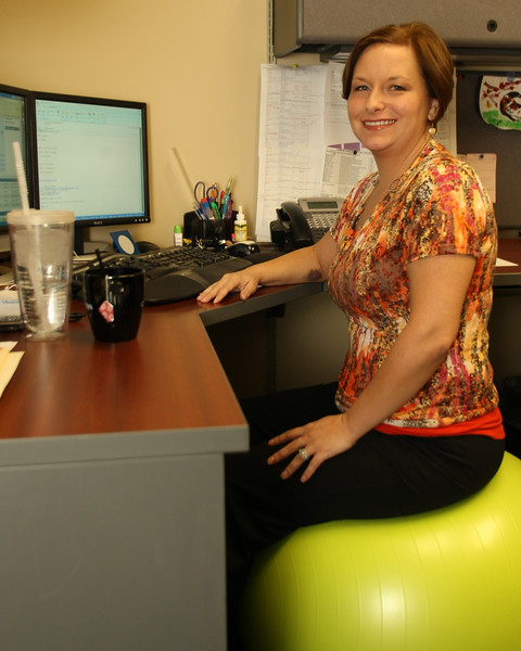 Tanya Brown, Client Service Advocate for Plan Benefit Analysis in Tulsa, uses a balance ball as while she sits at her desk to improve her core muscles.