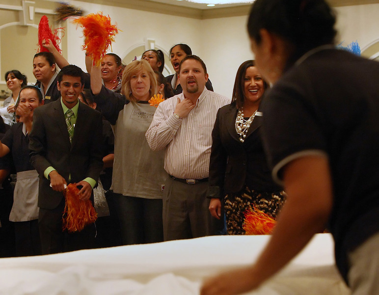 As her friends and co-workers cheer her on Maria Gomez competes in the Tulsa Hotel & Lodging Association Bed Making Contest bed making competition