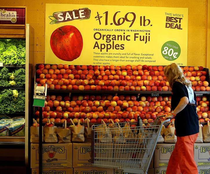 A shopper looks over organic produce at the Whole Foods store in Tulsa.