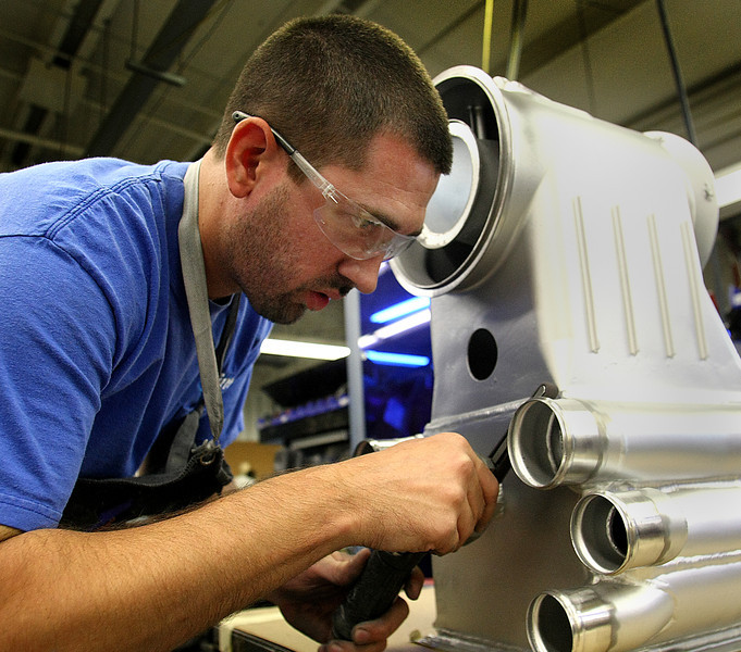 Limco Airepair technician Rick Ramos refurbishes a heat exchanger at the companies Tulsa shop.