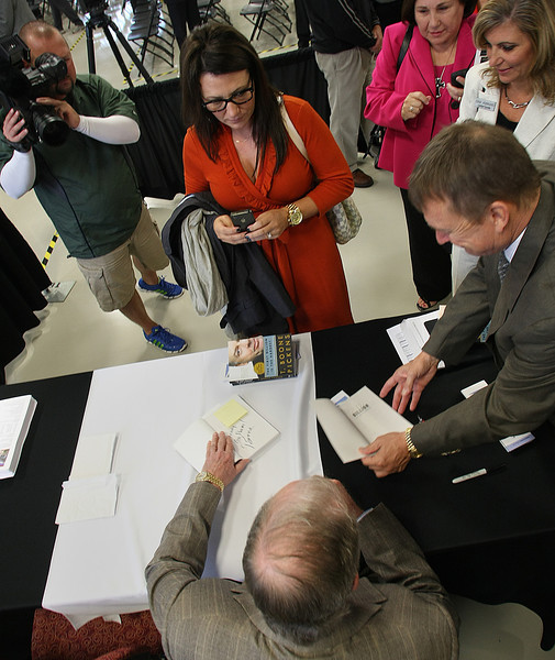 Boone Pickens signs a few books after the dedication of the Tulsa Tech Automotive, Robotics and Manufacturing campus in Broken Arrow.