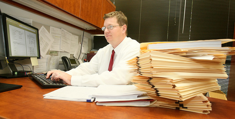 Brad Sutherlin, contracts compliance officer with OCAST. OCAST is switching from piles of paperwork to an electronic grant-filing process. PHOTO BY MAIKE SABOLICH