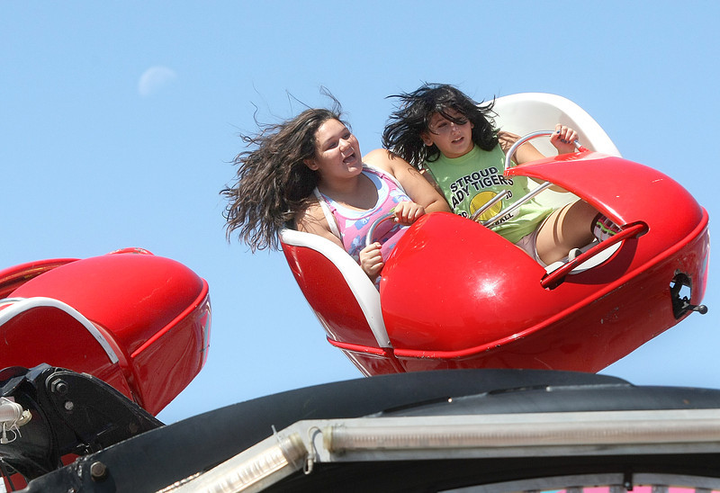 Megan Bucktror and Mandy Barsin ride the Spider at the Oklahoma State Fair Monday. PHOTO BY MAIKE SABOLICH