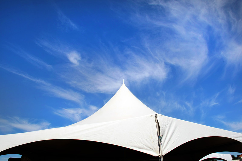 A tent against the blue sky during a ground breaking ceremony in Jenks.