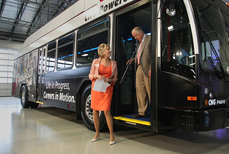 Boone Pickens and Dr. Kara Gae Neal. Superintendant of Tulsa Tech step off a CNG powered bus at the dedication of the schools Automotive, Robotics and Manufacturing campus in Broken Arrow.
