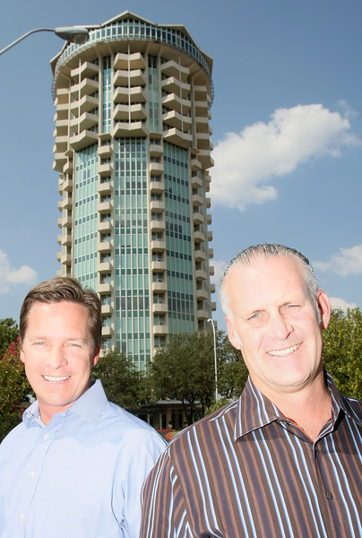 John Rupe, president of The Petrous Group, and Rod Meyer, president of Deep Fork Group, in front of Founder's Tower Friday.  Deep Fork Group is taking over the rotating restaurant space on the top floor of the tower. PHOTO BY MAIKE SABOLICH