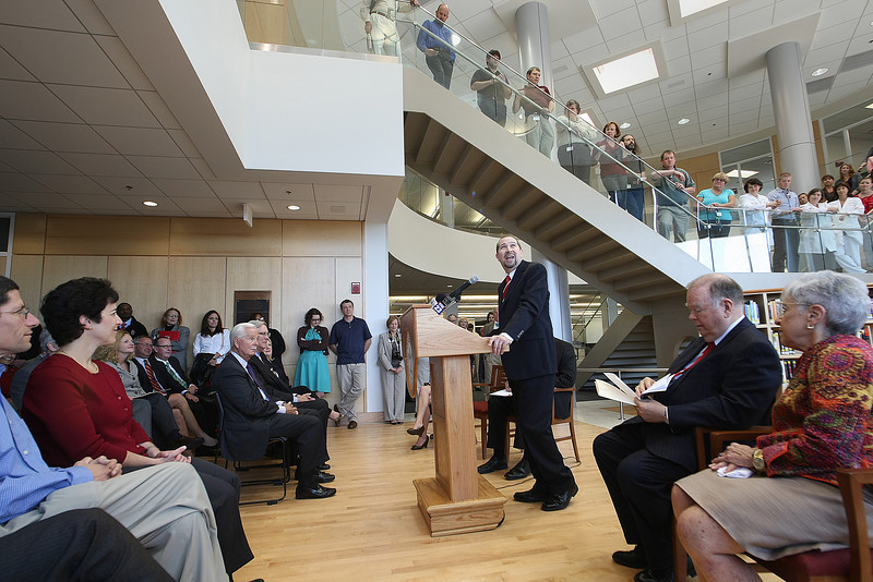 Spectators listen as Library Director Stewart Brower speaks at the dedication of the University of Oklahoma Tulsa Schusterman Library Monday.