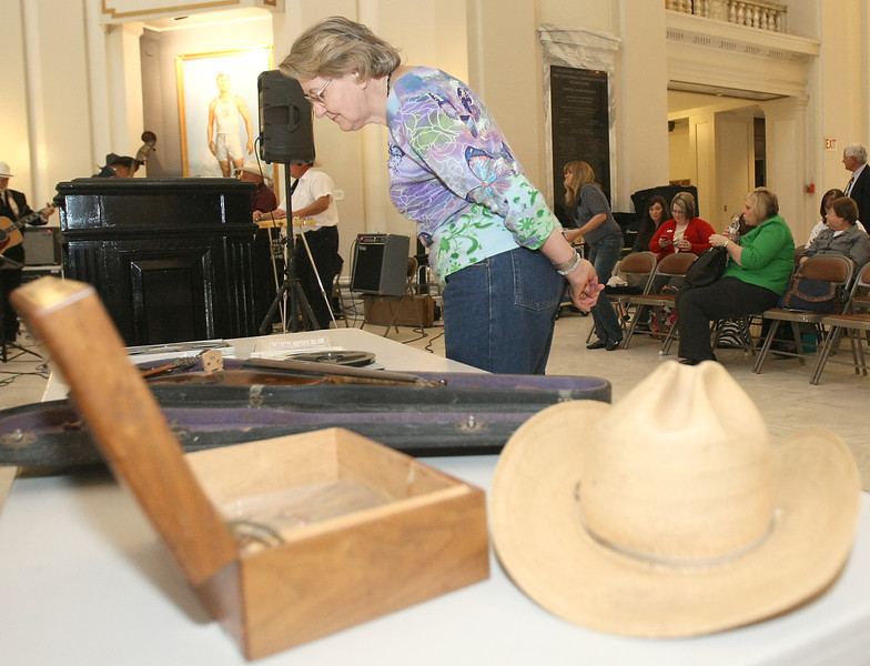 Melba Whitford checks out Bob Wills memorabilia Wednesday at the Capitol. PHOTO BY MAIKE SABOLICH