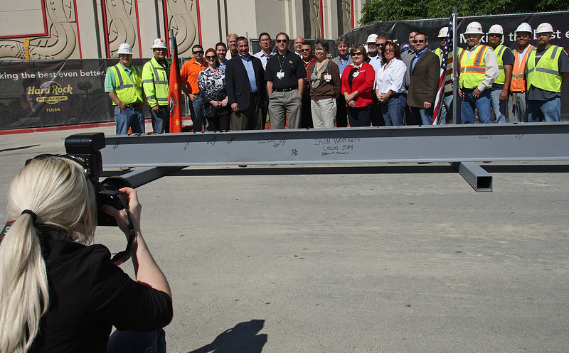 I photographer punches off a group photo in front of the last piece of steel to be placed during a topping off ceremony at the Hard Rock Casino in Catoosa.