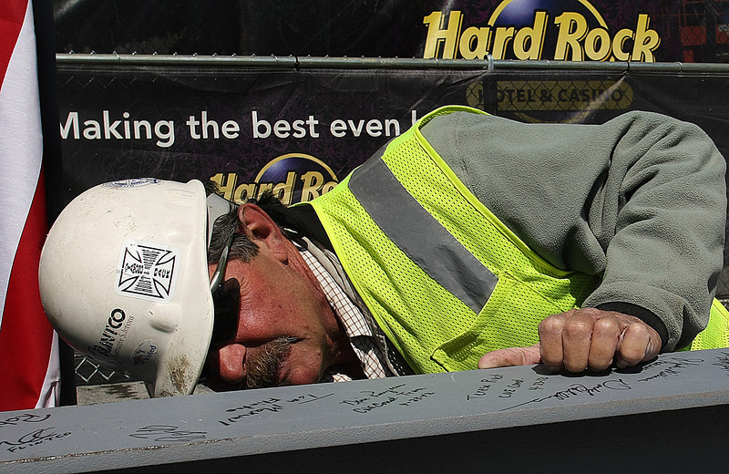 Iron Worker Dale Fielding signs the last piece of steel to be placed during a topping off ceremony at the Hard Rock Casino in Catoosa.