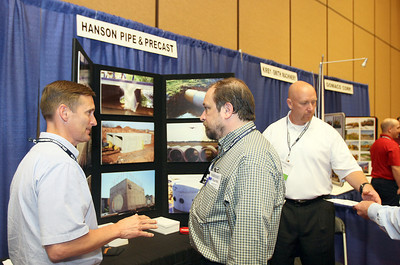 Walt Catlett with Hanson Pipe & Precast talks to Eduardo Elder during the 2012 Economic Summit in Norman Tuesday. PHOTO BY MAIKE SABOLICH