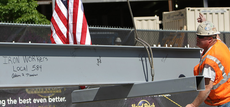 Iron Worker Adam Marshall directs the crane lifting the last piece of steel to be placed during a topping off ceremony at the Hard Rock Casino in Catoosa.