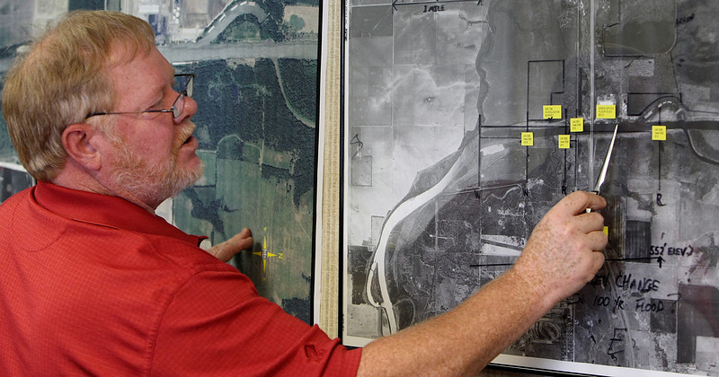 Steve Taylor, Vice President Johnston's Port 33, surveys a aerial map of his facilities on the Kerr Navigational waterway.