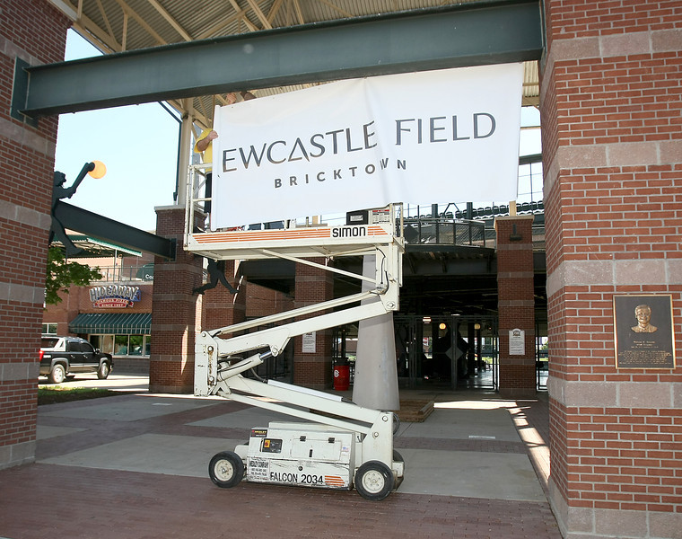 A temporary sign announcing the ballpark as Newcastle Field is installed Wednesday. PHOTO BY MAIKE SABOLICH