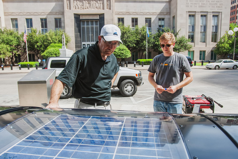 The city of Oklahoma City has installed 5 Big Belly Solar trash cans. The recepticals compact trash saving the amount of trips the city has to make to empty the trash. Tim Carlisle, left, is with Big Belly Solar and T.O. Bowmen, right, is with the cities Office of Sustainability.